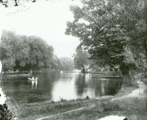 The lake at Boiling Springs; both sides of the lake can be seen and there are two canoes in the water.