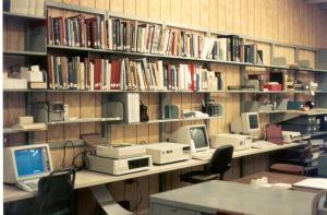 Photo of bookshelves and computer terminals in Hamilton Library.